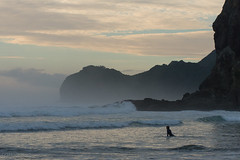 Evensong (Mike Brebner) Tags: autumn sea newzealand mist west beach water sport rock fog evening coast sand nikon surf waves surfer south lion surfing spray coastal nz april lone leisure nikkor piha d800 2014 cmikebrebner