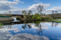 of ponds and sky (contemplative imaging) Tags: park railroad bridge blue sky reflection water wisconsin clouds cn reflections point landscape outdoors spring pond warm day cloudy stevens may tracks rail overcast canadian line ron national imaging monday dslr zack tamron contemplative wi 18200 embankment railroads 2016 wisc railline d7000 tam18200dx ciwisc20160503d7000335 20160503