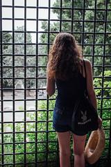 Trieste, 2016 (Antonio_Trogu) Tags: italia italy friuli trieste streetphotography girl castello ragazza donna looking watching behind grata grate antoniotrogu nikond3100 2016