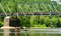 Boats pass under the Riverton-Belvidere bridge (a2roland) Tags: bridge trees men nature river landscape boats photo pass scenic picture norman photograph boating rowing passing delaware flicker zeb riverton belvidere a2rolandyahoocom normanzeb vunder