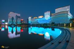 Tronspiration (Andy Brandl (PhotonMix.com)) Tags: china urban lake water reflections cityscape skyscrapers led electricity hangzhou tron modernarchitecture futuristic zhejiang binjiang g20 illuminatedarchitecture photonmix