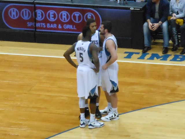 Martel Webster, MICHAEL BEASLEY, and Kevin Love huddle