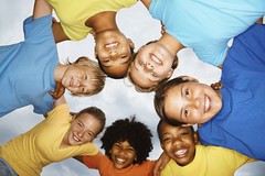 Upward view of smiling kids forming a unity huddle (display monitor 5) Tags: life girls friends boy portrait sky people playing color cute male boys girl beautiful beauty smile smiling kids female circle children fun happy person kid mixed child looking view friendship faces natural bright little head background unity small joy group young diversity lifestyle together leisure below ethnic playful huddle upward
