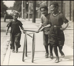 Children playing hoops on Chestnut St. (Toronto Public Library Special Collections) Tags: 1920s toronto children knickers games archives hoops multiculturalism historicalphotographs plusfours archivalphotographs darktoronto