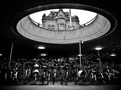 Bicycle Stall (Jeff Krol) Tags: street roof light sky blackandwhite bw building netherlands station bicycle circle fuji hole streetphotography bikes stall ceiling bicycles explore finepix fujifilm groningen levels x10 4x3 explored stabling jeffkrol fujix10 fujifilmfinepixx10