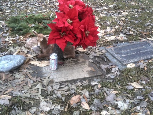 Headstone with a can of Budweiser on it.