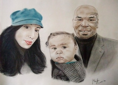 Boxing legend and actor Mike Tyson and family
