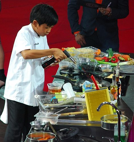 Philip prepares his dream dish, seafood Asian noodles, at the Junior MasterChef Pinoy Edition The Live Cook-off