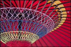 Parasol (Eric Flexyourhead) Tags: city pink blue red urban detail yellow japan umbrella tokyo parasol 日本 東京 bunkyo fragment bunkyoku nezu 根 文京区 olympusep1 panasoniclumix20mmf17