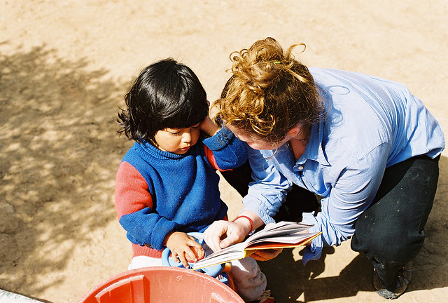 Student Reading to a Local Child