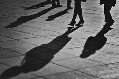 H(a)unting shadows (A. adnan) Tags: guangzhou china light shadow people bw monochrome lines standing walking nikon long pattern 85mm ground guangdong nikon85mmf18d d7000 gettyimageschinaq12012