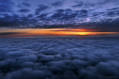 Sunset between the sheets (Dylan MacMaster) Tags: sunset clouds airplane horizon puffy fcs outofthewindow altocumulus stratocumulus fotocompetition fotocompetitionbronze