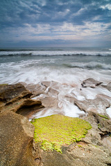 Coquina's Carpet (John Cothron) Tags: ocean longexposure cloud seascape beach water rock seashells 35mm canon landscape morninglight spring sand pattern florida cloudy scenic wave overcast atlanticocean saltwater ze stormyweather calcite sunshinestate coquina palmcoast flaglercounty windrain washingtonoaksgardensstatepark guanatolomatomatanzasnationalestuarineresearchreserve johncothron 5dmkii distagont2821 cothronphotography zeissdistagont21mm28ze 2jtrip20121 johncothron img08910120405