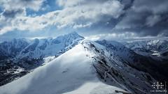 _DSC0811-3web (oolcgoo) Tags: schnee snow berg clouds rocks europa europe sony wolken polen sal slt ssm tatra hohe kasprowy wierch sal1650