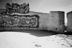 V22Monument (MrSleepyhead) Tags: analog analogue film blackandwhite bwfilm bw schwarzweiss sw swfilm nikonf5 nikon nikonafd24mmf28 wideangle xtol 11 kodak kodaktmax100 tmx mazedonien macedonia fyrom ejrm kocani osogovo monument illinden mosaik mosaic kunst hero heroism helden krieg war befreiung freedom liberation jugoslawien yugoslavia landscape landschaft landmark filter filtered rotfilter red architecture architektur youth jugend jugendliche hangout fallen verfallen erode ruine ruin dilapidated alt old communist kommunist graffitti graffiti grafitti grafiti monochrome outdoor art panorama ausblick view übersicht balkan