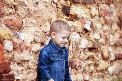 Shy to smile.. (Ireine Photography) Tags: kids boy ireinephotography prague summer sunshine wall red georgeous cute small jacket 2016 ireine photography portrait portraits smile shy