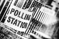 Meet The New Boss; Same As The Old Boss (Howard Sandford) Tags: bw monochrome sign democracy strength society railings masses pollingstation weakness plebian blackandwhitebnw