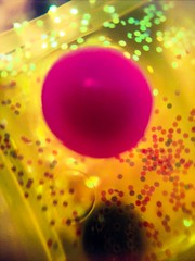 Big and Little (Thad Zajdowicz) Tags: bubbles bright indoor inside abstract happymacromonday macro cellphone easymacro photoshopexpress motorola droid turbo minimal yellow pink