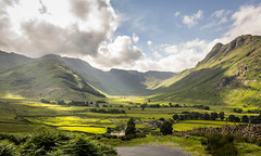 The sun always shines on the righteous (ian.emerson36) Tags: road trees sky sun mountains green beauty clouds landscape photography rocks natural lakes lakedistrict hills valley cumbria stunning winding agriculture sunrays langdale
