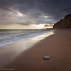 Chink (Sarah_Brooks) Tags: ocean light sea seascape beach water coast seaside shingle shore dorset drama jurassic burtonbradstock jurassiccoast moodysky