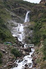 Crossing beautiful waterfalls on a Multi sport treking Mountain biking rafting kayaking trip in Nepal