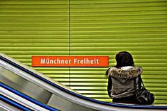 freiheit (Fotoristin - blick.kontakt) Tags: urban orange woman green lines station underground subway mnchen ubahnhof escalator rolltreppe mnchnerfreiheit linien