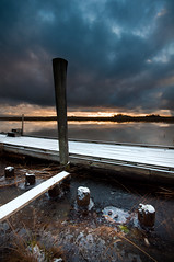 Thin ice II (- David Olsson -) Tags: winter sunset lake snow cold clouds log nikon december cloudy sweden jetty board sigma karlstad poles 1020mm 1020 vänern värmland thinice 2011 d5000 floatingpier kanikenäset davidolsson kanikenäshamnen 2exposuremanualblend ginordicfeb12