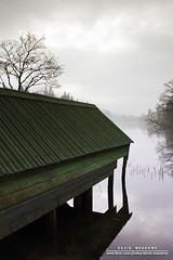 Down by the Boathouses (DMeadows) Tags: trees roof house mist lake green water misty rural reflections reeds scotland countryside boat haze shadows boating loch hazy boathouse trossachs corrugated secluded aberfoyle davidmeadows dmeadows davidameadows dameadows yahoo:yourpictures=waterv2 yahoo:yourpictures=yourbestphotoof2012 yahoo:yourpictures=reflectionsv2