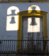 The bells! (steverichard) Tags: door travel shadow building abandoned church window yellow photo spain image bell balcony rusty andalucia structure espana andalusia derelict crusty arcos steverichard
