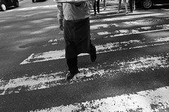 Buenos Aires -1010668 (Jacobo Zanella) Tags: buenosaires argentina travel bw candid argentinos urban scene city street portrait nolook fromthehip sinver hip march 2012 dlux 4 jacobozanella waiter crossing zebra black contrast step cropped tray coffee feet wheels stripes faded decay walking dlux4 stranger strangers extrao extraos portraiture jz76