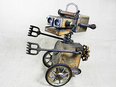 Robot Assemblage Sculpture - MONTY - Reclaim2Fame (Reclaim2Fame) Tags: metal altered toy tin robot rust recycled assemblage mixedmedia figure foundobject recycledmaterials robotsculpture salvageart reclamationart