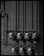 Pipes and Meters Downtown (mat4226) Tags: light shadow ohio red urban film field metal composition landscape rust paint downtown nw fuji northwest w pipes pipe hard shift system line 8x10 xray oh form meter f56 rise shape chipped findlay meters fujinon zone asa100 ortho filmphotography fieldcamera orthochromatic eastmankodak 11100 210mm pyrocathd 8x10film xrayfilm stainingdeveloper nwoh eastmancommercialb compensatingdeveloper dilutedeveloper greensensitive