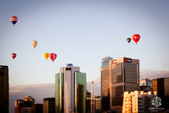 Balloons Over Melbourne... (Phillip Norman Photography) Tags: city morning sky lensbaby melbourne grandprix hotairballoons explore14 phillipnormanphotography edge80 philnormanphoto