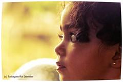 Kuhu and her curly locks (trdastidar) Tags: portrait india children nikon raw kerala backlit wayanad backlighting childrensportrait kalpetta d80