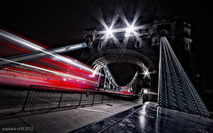 Into the gaping mouth of London / Tower Bridge (zzapback) Tags: uk bridge light red england urban bus london tower robert thames towerbridge mouth river big rotterdam nikon fotografie angle riverside stripes united capital wide trails sigma kingdom belly beast brug ultra 1224mm stad queenswalk doublede