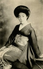 Geiko in an Aranami Kimono 1921 (Blue Ruin1) Tags: japan bench japanese sitting seagull postcard hairdo wave geiko geisha hairstyle seated seaspray coiffure nami kamome wildwave stormyseas taishoperiod aranami ragingwaves hangingcharm sokuhatsu crestedkimono kakemamori watermotifs