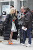 A stylist helps AnnaSophia Robb with a wardrobe malfunction while on the set of 'The Carrie Diaries' in Manhattan New York City, USA