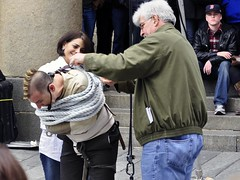 Tighter! Tighter! (AntyDiluvian) Tags: boston downtown escape massachusetts volunteers rope skeptical mohawk streetperformer marketplace tied quincymarket faneuilhall straitjacket escapeartist tighter jasongardner jasonescape