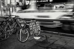 Melbourne (alessandro.soro) Tags: street white black monochrome sign outdoors jesus australia melbourne ambulance died sins bycicle