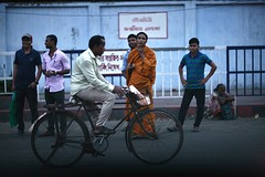 Ride Away.... (N A Y E E M) Tags: street men bicycle dusk monk windshield bangladesh chittagong norahmedroad