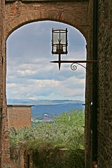 Up hill view. Arch and light (Emanuele Barcali) Tags: vacation sky italy sun black green tower love clouds countryside photo san artist view gimignano weekend withe sunny medieval hills tuscany sangimignano castello borgo castel torri blackwithe togheter