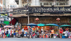 Bangkok Chinatown (Evgeny Ermakov) Tags: street city red people urban asian thailand town asia southeastasia chinatown market bangkok crowd police motorbike moto vendor marketplace local southeast sell selling seller crowded streetmarket editorialuse