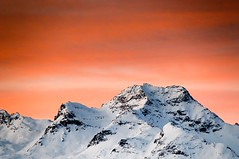 Sunrise in St. Moritz (5ERG10) Tags: morning pink light orange white mountain holiday snow black ski mountains sergio montagne sunrise dawn hotel switzerland early nikon rocks january crest telephoto neve peaks nikkor svizzera sci gennaio stmoritz d300 2011 18200mm kulm amiti 5erg10