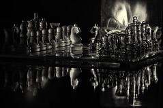chess by candlelight b&w (loco's photos) Tags: light shadow blackandwhite bw game macro reflection glass lamp set lowlight candle shadows pieces pentax board chess olive oil candlelight kr hdr frosted chessmen oliveoillamp incamerahdr panagor9028
