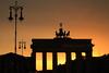 Brandenburger Tor, Berlin, DE - 2011.09.05 (Blind_BlindBlind) Tags: sunset sky berlin silhouette digital canon germany deutschland is skies zoom dusk burning kit 1855 dslr brandenburgertor allemagne goldenhour singlelensreflex pariserplatz lampposts goldenlight 500d réflex efs1855mmf3556 lampadaires portedebrandebourg réverbères apsc eos500d canoneos500d eoskissx3 rebelt1i kissx3 eosrebelt1i