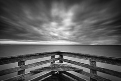 A Shared Morning on the Chesapeake Bay (jeffsmallwood) Tags: longexposure morning sky blackandwhite water clouds sunrise dawn pier maryland northbeach drama chesapeake chesapeakebay