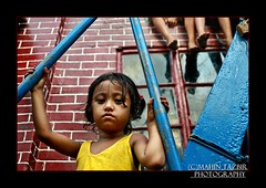 'N' for negligence... (Tazbir Mahin) Tags: poverty blue red girl yellow nikon slum harsh poignant d7000