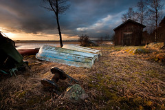 Forgotten (- David Olsson -) Tags: old trees sunset lake building abandoned water rock clouds boats evening moss spring nikon upsidedown cloudy sweden decay tripod sigma dirty hut filter worn april late shack 1020mm grad dramaticsky 1020 hitech tarpaulin tye vnern 2012 warmlight darksky dx hammar vrmland redcanoe drygrass gnd d5000 davidolsson tyns 2exposuremanualblend 12soft vstratye