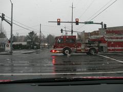 Ladder Truck Racing Through an Intersection (born1945) Tags: red snow oregon truck fire engine firetruck ladder hillsboro spartan