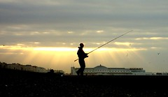 Brighton Fisherman at dawn (brightondj) Tags: sea people silhouette dawn fishing fisherman sand brighton westpier brightonbeach seafishing springtide
